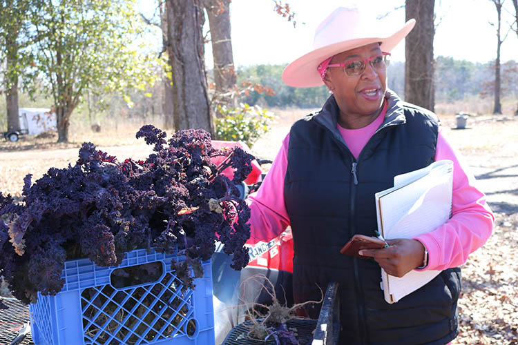 Dr. Cindy Ayers-Elliott with baskets of produce.