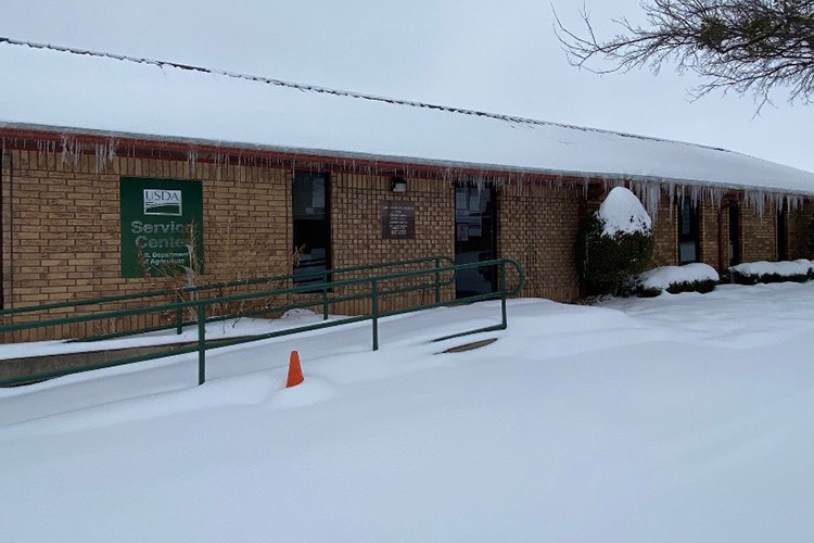 Snow blankets the USDA Service Center in Clay County, Texas.