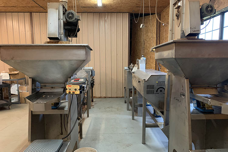 The farm runs two commercial cracking units with the capability of cracking 1,000 pecans per minute. Photo: Kelsey Chambers, FSA.