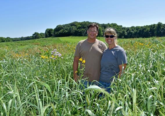 Molly and John Heaps stand on their farm