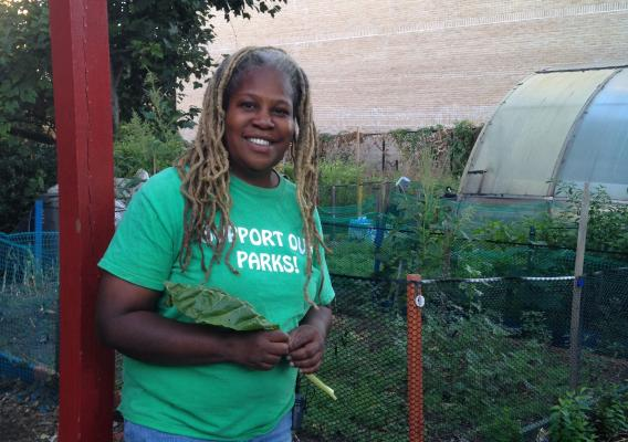 Karen Washington standing in front of her urban farm