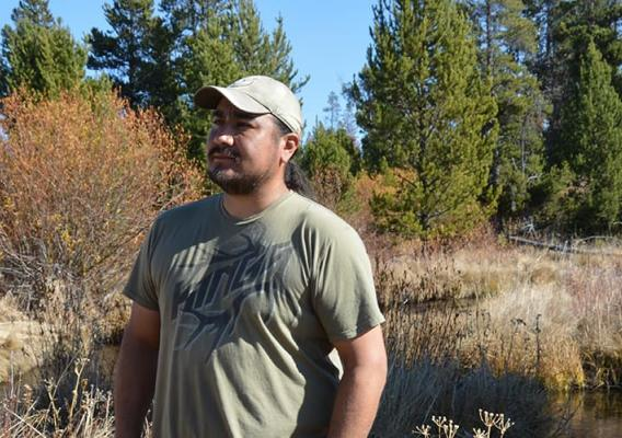 Eric Hawley, Burns Paiute Tribal chair observes the new growth along the banks of Big Creek.
