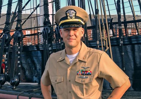 US Navy Lieutenant Daniel Longwell in front of a ship