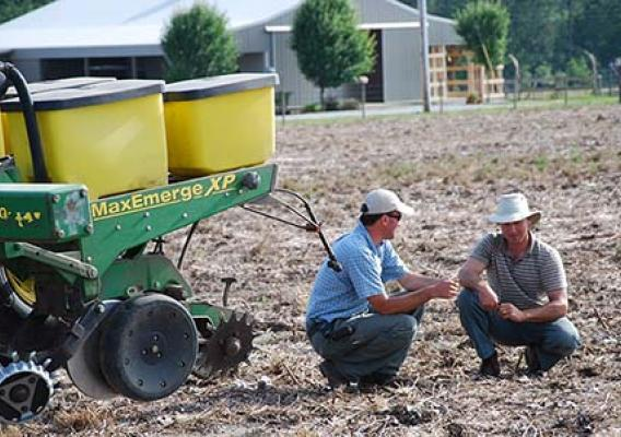 Joey Koptis (left) discusses soil health with Michael Mullek (right), a row crop farmer in Alabama