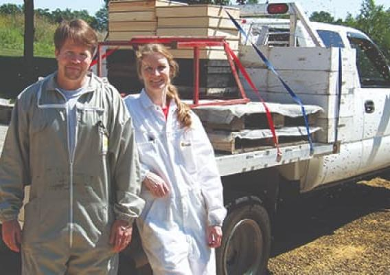 Tim McDonald and his wife, Dana, in front of a truck