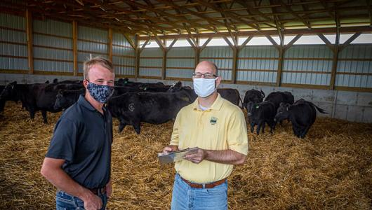 Ethan Whiteside (left) working with USDA on his operation.